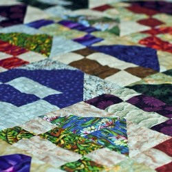 Put together a community quilt to raise money for your creative project.