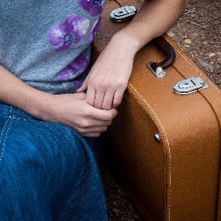 Create luggage tags to sell as away to raise funds for travel.